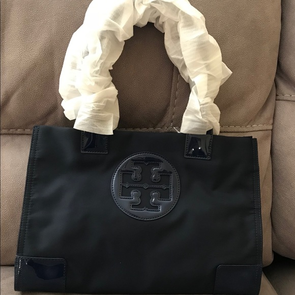afe81d10789c Tory Burch Ella Nylon Mini Tote - French Navy. Tory Burch.  M 5b05f5bb50687c8e7cd643ea. M 5b05f5bc9a94555202988bb9.  M 5b05f5bd5521be4409c47a7d